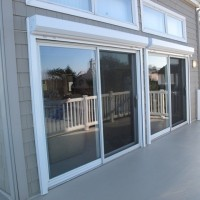 Hurricane Shutters - Motorized Rolling Shutters - Open